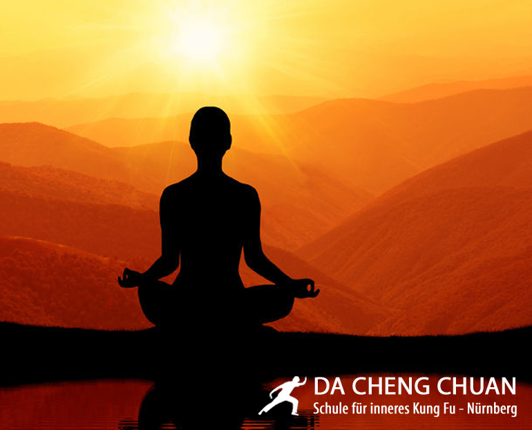 42168141 - man meditating in yoga position on the top of mountains